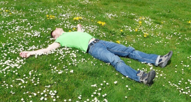 Man-Sleeping-Grass-Field